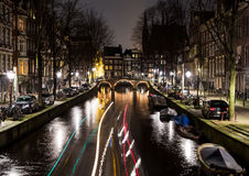 Leidsegracht Canal in Amsterdam at Night. A view along the  Leidsegracht canal in Amsterdam at night. The trail from a boat cna be seen Stock Photography