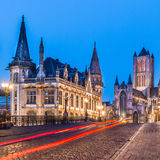 Leie river bank in Ghent, Belgium, Europe. Picturesque medieval buildings around Korenmarkt square ( Saint Nicholas' Church, The Celtic Towers,... ) overlooking stock photo