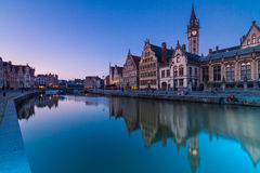 Leie river bank in Ghent, Belgium, Europe. Picturesque medieval buildings overlooking the Graslei harbor on Leie river in Ghent town, Belgium, Europe stock images