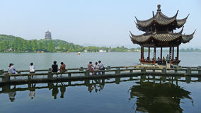 Leifeng Pagoda with stone bridge  in West Lake Royalty Free Stock Images