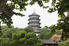 Leifeng pagoda was surrounded by green trees. Leifeng pagoda, called Leifeng tower, located in Hangzhou city, Zhejiang province, China. It not only is a tower stock photo