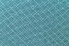 Leinengewebebeschaffenheit des blauen Sofas für Hintergrund Stockfotografie