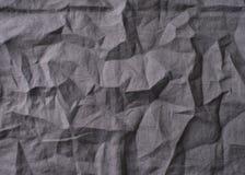 Leinenstoff des Hintergrundes und der Beschaffenheit graues Textil, wrikles und zerknittert lizenzfreies stockbild