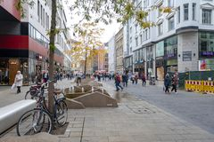 Central business district and city square near Augustusplatz in downtown Leipzig, Germany. Leipzig, Germany - October 2018: Pedestrians on street alongside with royalty free stock photography