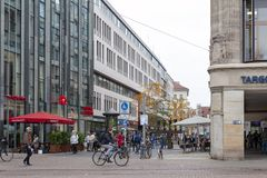 Central business district and city square near Augustusplatz in downtown Leipzig, Germany. Leipzig, Germany - October 2018: Pedestrians on street alongside with royalty free stock photo