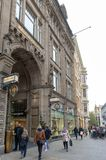Central business district and city square near Augustusplatz in downtown Leipzig, Germany. Leipzig, Germany - October 2018: Pedestrians on street alongside with stock photography