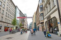 Central business district and city square near Augustusplatz in downtown Leipzig, Germany. Leipzig, Germany - October 2018: Pedestrians on street alongside with stock photos