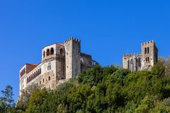 Leiria, Portugal. Medieval Leiria Castle built on top of a hill. With a view over the Gothic Palatial Residence or Pacos Novos. A Templar Knights Castle stock photography