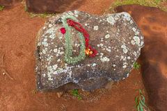 Leis on Hawaiian Birthing Stones stock images
