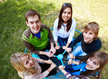Leisure. Circle of happy friends looking at camera with smiles at leisure stock images