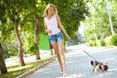 Leisure. Portrait of happy female strolling with her pet at leisure royalty free stock photography