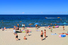 Leisure activities on the sandy beach at Kulikovo. KULIKOVO, RUSSIA — JULY 19, 2014: Leisure activities on the sandy beach at Kulikovo, Kaliningrad region Stock Photography