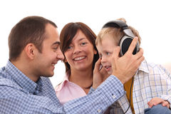 Leisure activity - family. Mother father and son listen to music - leisure activity Royalty Free Stock Images