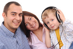 Leisure activity - family. Mother father and son listen to music - leisure activity Stock Image