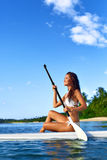 Leisure Activity. Woman Stand Up Paddling, Surfing. Recreational Royalty Free Stock Photography