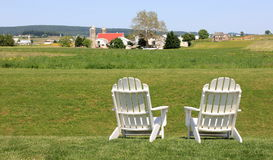 Leisure adirondack chairs Stock Image