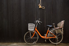 Leisure Bicycle in front of black wooden fence Royalty Free Stock Image