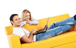 Leisure on bright yellow sofa Royalty Free Stock Photography