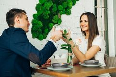 Smiling couple having dinner and drinking white wine at date in restaurant. Leisure, celebration, food and drinks, people and holidays concept - smiling couple Stock Photo