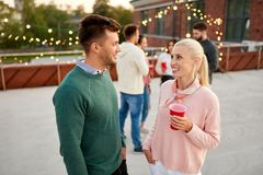 Friends with non alcoholic drinks at rooftop party royalty free stock image