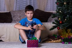 Leisure, children, technology, internet communication and people concept - smiling boy with smartphone texting message or playing. Leisure, children, technology stock image