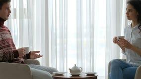 Leisure communication couple conversation tea. Family home leisure. communication conversation. couple talking. man and woman drinking tea stock video footage