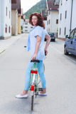 Leisure fashion. Older woman in fashionable summer clothes by bike Stock Image