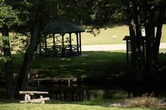 Leisure gazebo in the forest and garden. Season of autumn. September Month Royalty Free Stock Photo