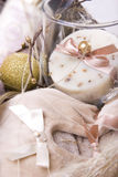 Leisure gift kit. Closeup of leisure kit made of velvet ballet slippers, gold ball and spa soap Stock Photography