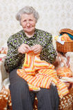 Leisure grandmother. Pretty grandmother in glasses knit Royalty Free Stock Images