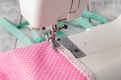 Leisure hobby concept, sewing machine at home with pink polkadot Royalty Free Stock Image