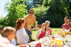 Family having dinner or barbecue at summer garden royalty free stock photos