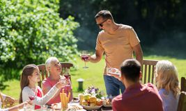 Happy family having dinner or summer garden party Royalty Free Stock Photography