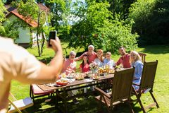 Happy family photographing by smartphone in summer Stock Photography