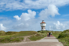 Leisure on Langeoog, Germany. Strolling in the dunes and water tower of the East Frisian island Langeoog, Lower Saxony, Germany Stock Photography