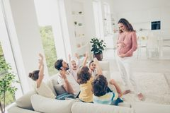 Leisure, lifestyle concept. Photo of positivity, glad, enjoy, re. Joice pregnant mother came to the lovely kids and her husband sit on couch in modern light stock photography