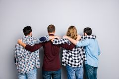 Leisure lifestyle leadership success virility masculinity brothe. Rhood help concept. Handsome attractive different men, checkered denim clothes, putting arms on Stock Photography