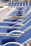 Leisure - Lounge Chairs on Deck of Cruise Ship. Towels Placed On Lounge Chairs On Deck Of Cruise Ship royalty free stock photography