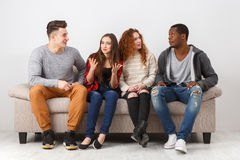 Leisure and party time, friends sitting on couch Stock Image