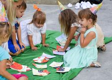 Leisure of preschool children. Animators at a children's party. Acting and developing games for children. Stock Photo