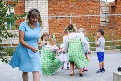 Leisure of preschool children. Animators at a children's party. Acting and developing games for children. Village Poltavskaja, Russia - September 8, 2017 Stock Photos