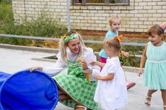 Leisure of preschool children. Animators at a children's party. Acting and developing games for children. Village Poltavskaja, Russia - September 8, 2017 Royalty Free Stock Image
