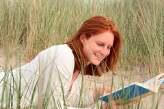 Leisure Reading on the Beach Stock Photography