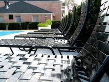 Leisure Relax. Relaxation chair in the middle of swimming pool with building background Royalty Free Stock Images