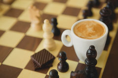 Leisure relax time or business strategy concept. Part of chess table with coffee cup Royalty Free Stock Photo