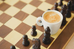 Leisure relax time or business strategy concept. Part of chess table with coffee cup Royalty Free Stock Photos