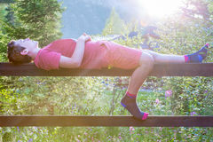 Leisure and relaxing outdoors summer evening, teenage boy laying down. Royalty Free Stock Photo