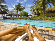 Leisure in Summer. Body part of a couple enjoying a spectacular summer day in a swimming pool of a spa in brazil, south america Royalty Free Stock Photos
