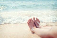 Leisure in summer - Beautiful leg of sexy women tan Royalty Free Stock Image