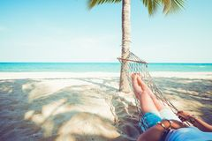 Relax and sunbathe on hammock at sandy tropical beach royalty free stock photo
